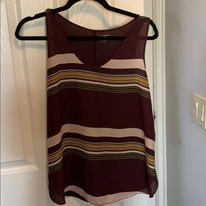 Burgundy with stripes. Back is plain